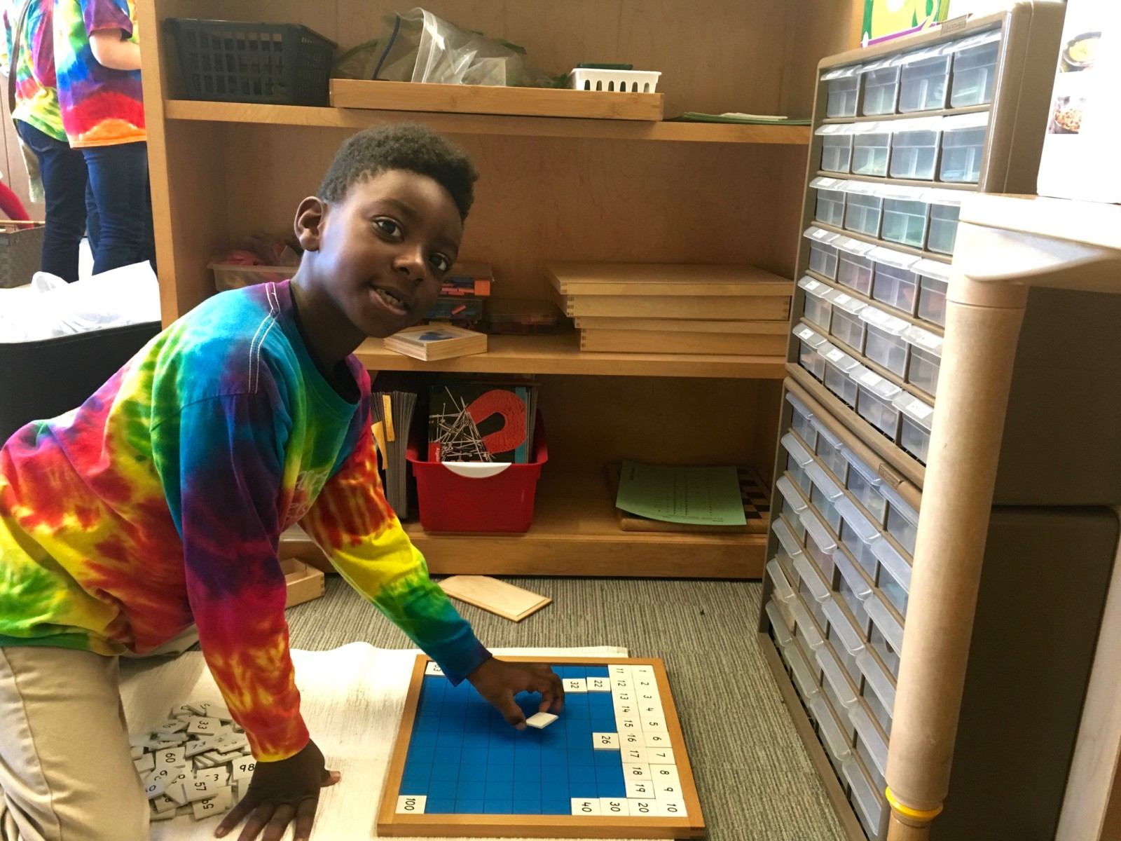 Student works on Montessori materials in the classroom