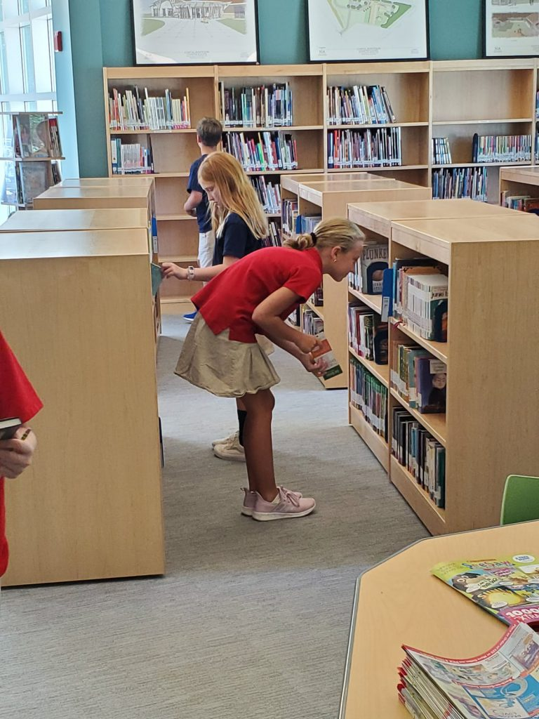 Student browsing for books at the library