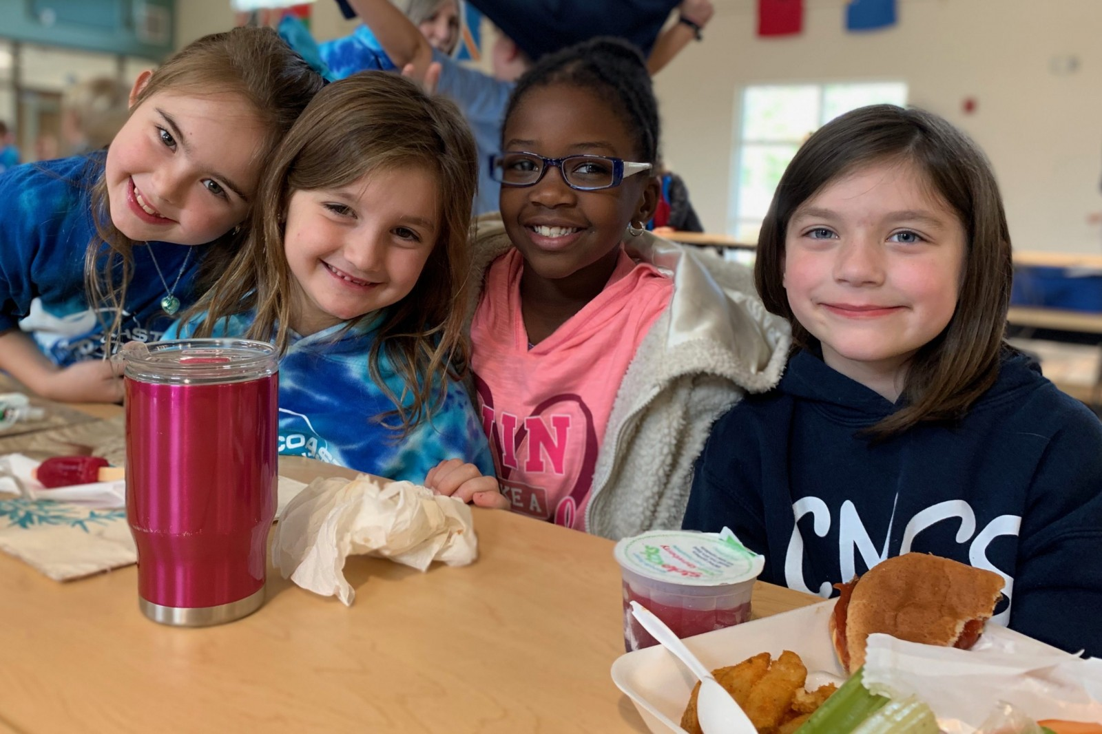 Lower Elementary girls eating lunch